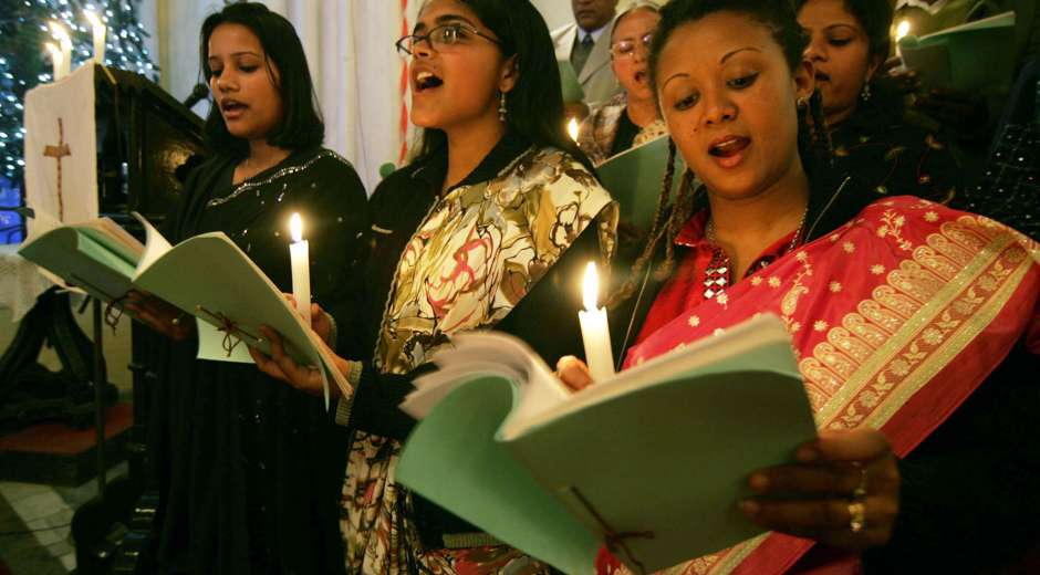 Indian Christians offer prayers during a service ahead of Christmas in Amritsar on December 22, 2008. Despite ...