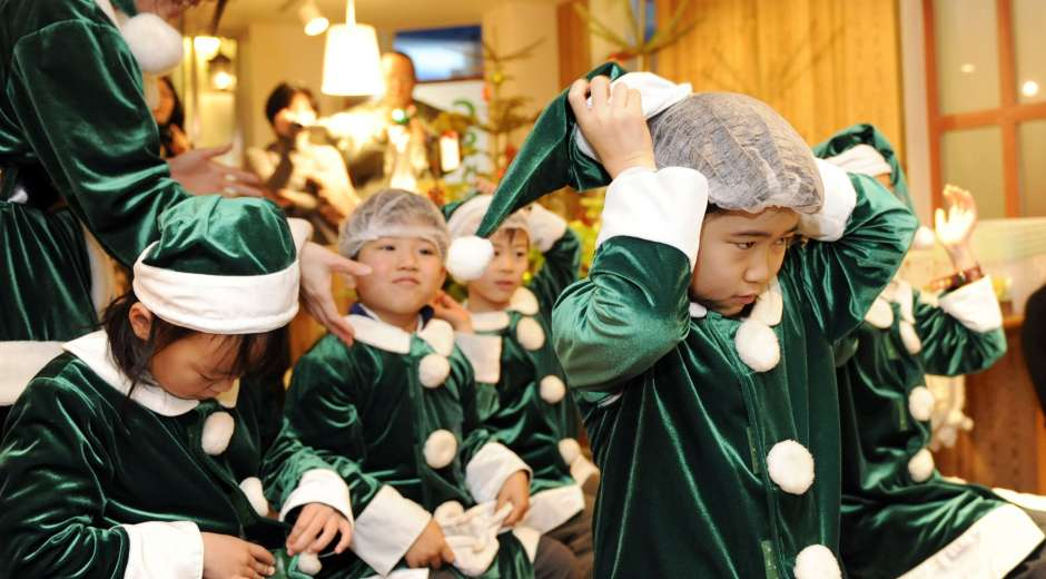 Little Santa Claus trainees wear green suits as they learn how to work for ecological friendly Green Santa ...