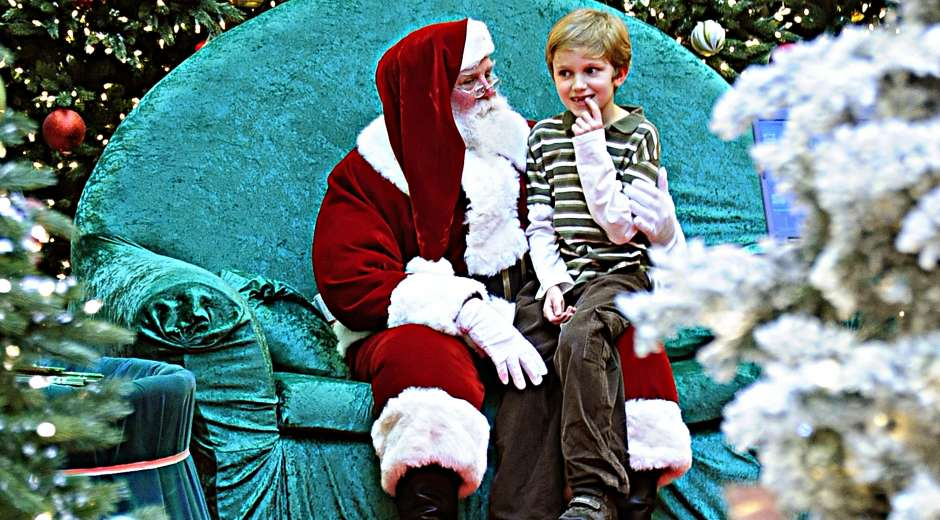 A young boy tries to tell Santa Claus what he would like for Christmas on December 20, 2008 at the Tysons ...