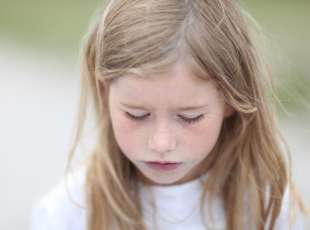 *** ROYALTY FREE - special pris *** Cute little girl sadly looking down. Displeased, sad, childhood, ...