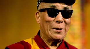 Tibetan spiritual leader the Dalai Lama wears a pair of sunglasses he received after his lecture in Amsterdam ...