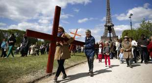"Pilgrims attend the annual Good Friday ""Stations of the Cross"" procession at the Champs de Mars ..."