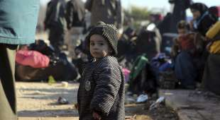 A young Syrian child evacuated from the embattled Syrian city of Aleppo during the ceasefire arrives at a ...