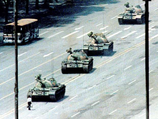 A Beijing citizen stands in front of tanks on the Avenue of Eternal Peace in this June 5, 1989 file photo ...