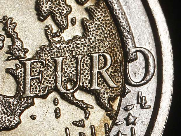 The map of Europe is featured on the face of a two Euro coin seen in this photo illustration taken in Rome, ...