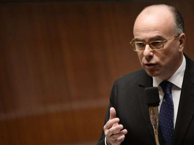 French Interior Minister Bernard Cazeneuve answers Members of Parliament's questions during a session of ...
