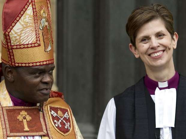 Bishop Libby Lane (R) poses for pictures with Archbishop of York, Dr John Sentamu, as she leaves York Minster ...