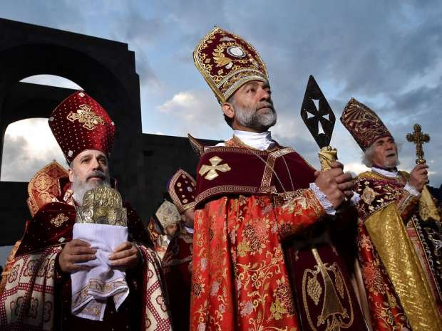 Clerics take part in the canonization ceremony for the victims of the Armenian Genocide in Echmiadzin, ...