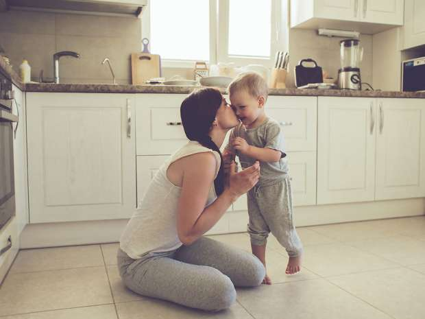 Mom with her 2 years old child cooking holiday pie in the kitchen to Mothers day, casual lifestyle photo ...