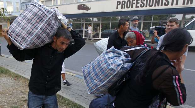 A Roma family arrives at Baneasa international airport in Bucharest from Marseille, in the latest wave of ...