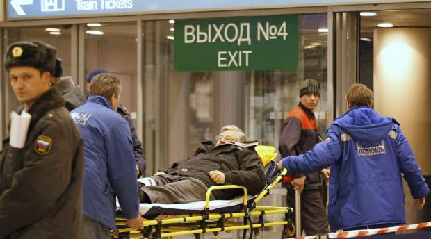 A victim of a bomb explosion is wheeled out by medics at Moscow's Domodedovo airport January 24, ...