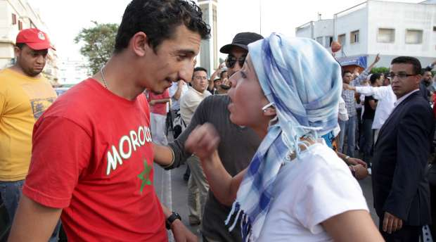 A supporter of anti-constitution argue with a pro-monarchy activist during a demonstration after King ...