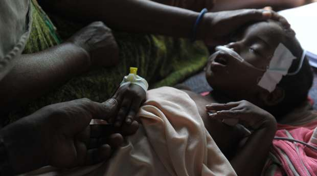 Abshira Abdukadir, a four-year-old Somali girl suffering from severe diarrhea and having trouble breathing, ...