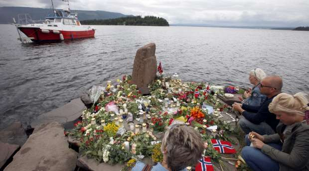 People pay their respects for the victims in last Friday's killing spree and bomb attack, on the shore ...
