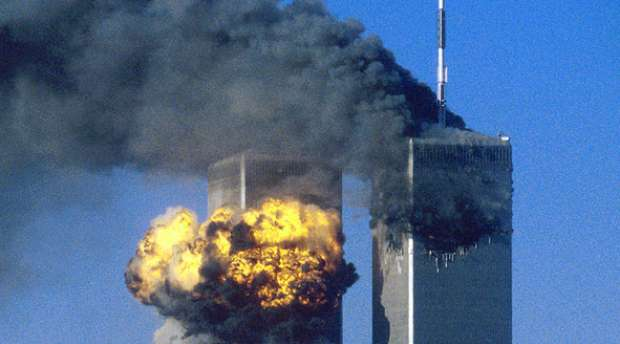 The World Trade Center south tower (L) burst into flames after being struck by hijacked United Airlines ...