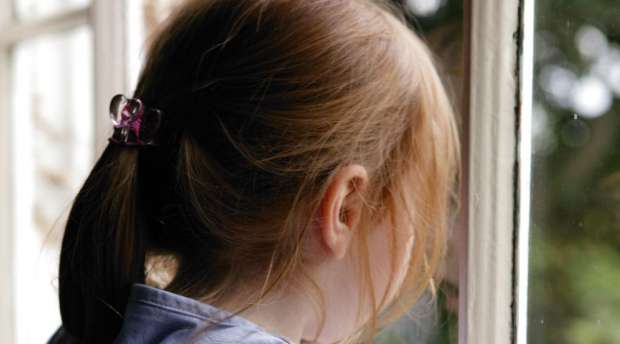 Young girl looking out a