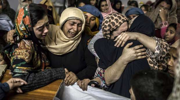 Women mourn their relative Mohammed Ali Khan, 15, a student who was killed during an attack by Taliban gunmen ...