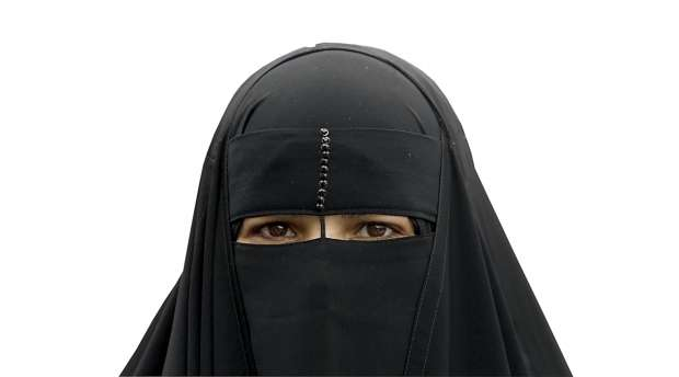 An Egyptian woman anti-government protestor wears a full veil, or niqab, at Tahrir Square in Cairo February ...